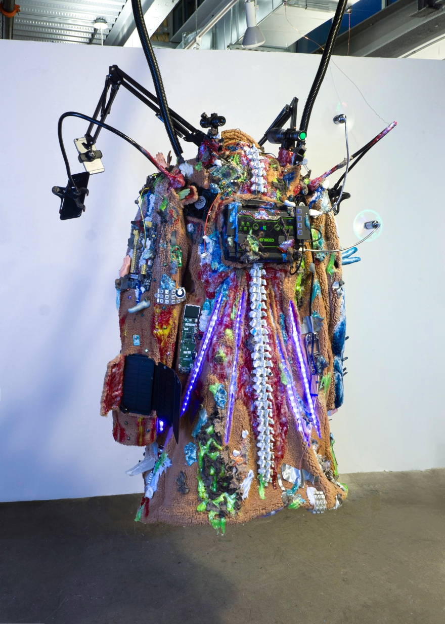 "Yeom-la Daewang Suit 1 (back), iPhone 6, power generator, solar panel, tablet, computer, speaker, laser, LED light, clothes, silicone, resin, epoxy clay, gemstone, crystal, mixed media, 52x36x22.5"", 2020.jpg"
